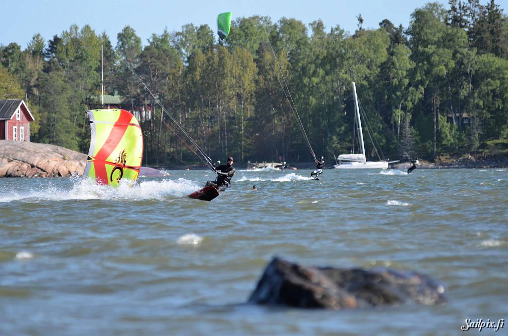 Kiteboarders at Lauttasaari Casino Beach enjoying sunny weather and good wind.