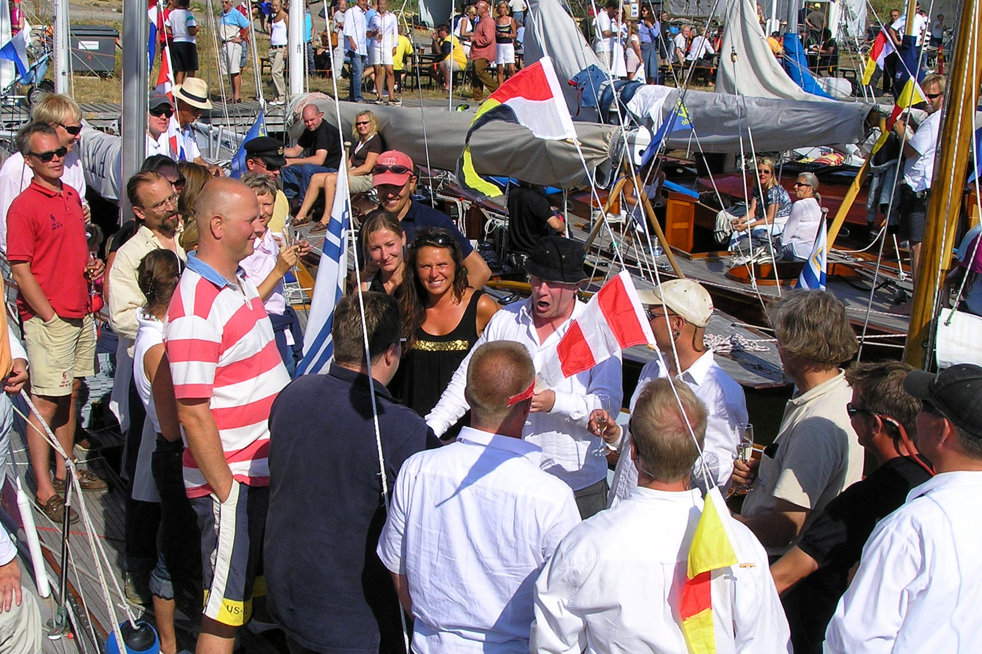 "Some 6mR sailors at the annual wooden boat race ""Viaporin Tuoppi"" after sail. Including photos from 6mR FIN-36 Mariana's 70 years celebration."