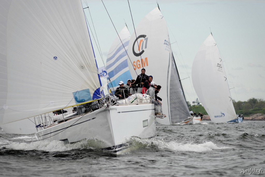The prestigeous Swan 60's in the Nord Stream Race leaving Helsinki after a weekend stopover. Weather cloudy, temperature around 15 deg. C and a nice 6-8 m/s tailwind helping the yachts to escape from the approaching eastern rain front. Thanks to Eero Lehtinen at windx.fi for the news feed and keeping Sailpix updated.