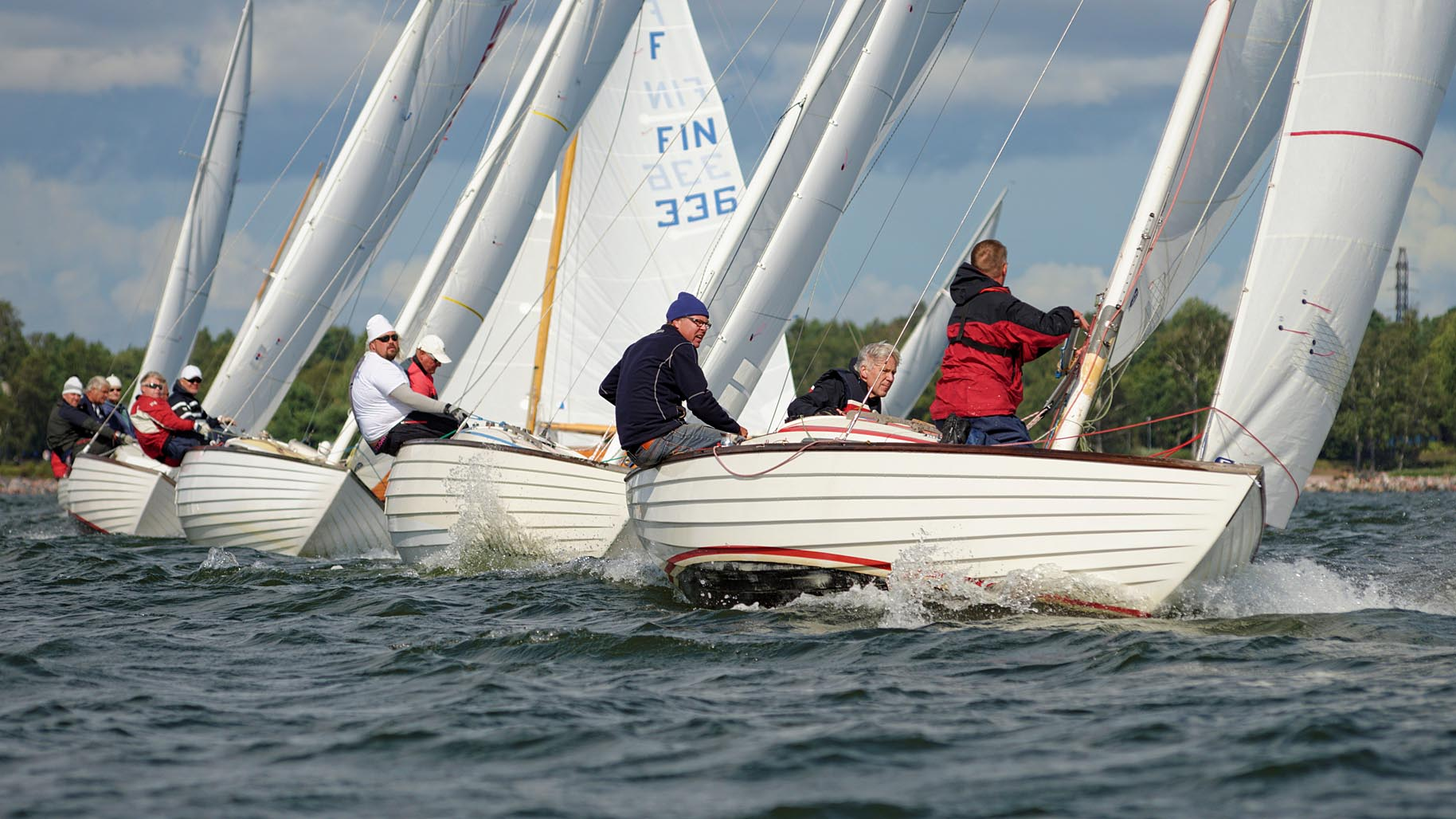 First day at the Nordic Folkboat Finnish Championship organized by HTPS. Perfect sailing weather in warm breeze from South-west at Kruunuvuorenselkä in Helsinki. Photos are from the first day of total three. Two boats from Naantali, with Herman Saari and Roni Saksi at helm, leading after the first day. Results.